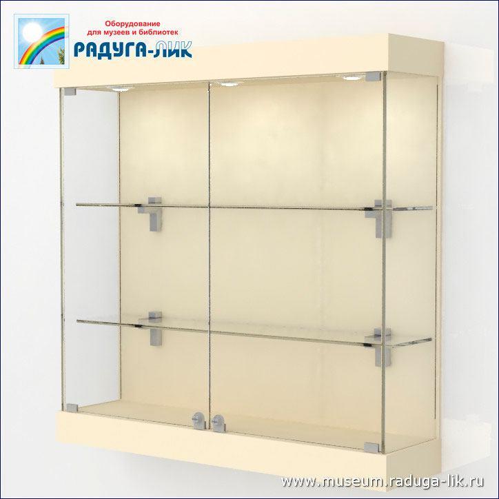 Настенная выставочная витрина с полками и врезными стёклами.